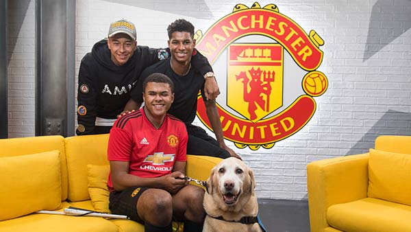 Rainbow meets Marcus Rashford at Manchester United FC for Guide Dogs